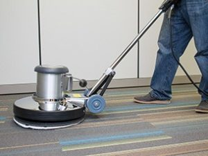 Carpets getting cleaned with rotary brush