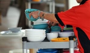 singapore cleaner clearing food plates